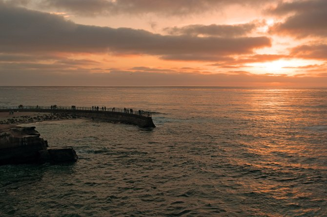 At the seal beach of San Diego, a Sunset was really beautiful with a cold breeze fro the shore.