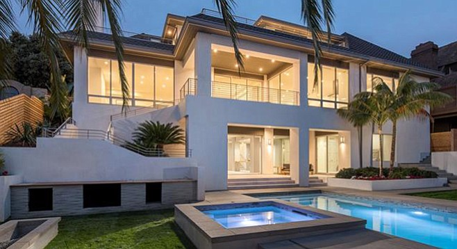 The saltwater pool and low-maintenance backyard are among the selling points